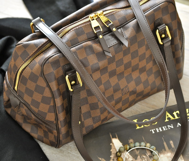 The Louis Vuitton Rivington GM in Damier Ebene has unique features and is actually a Louis handbag that is not seen as often making it even more special.