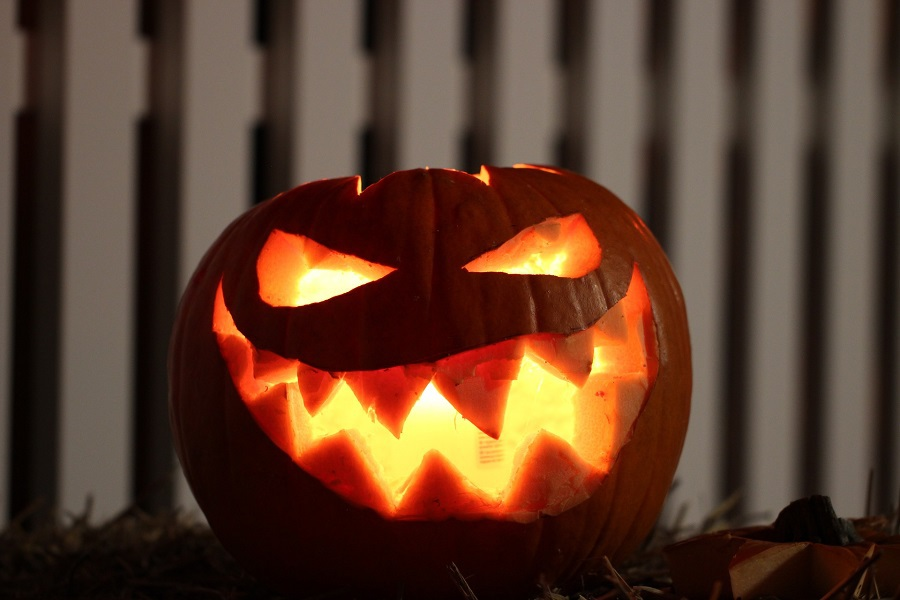 Downloads for your Halloween Playlist Carved Pumpkin with a Candle Inside