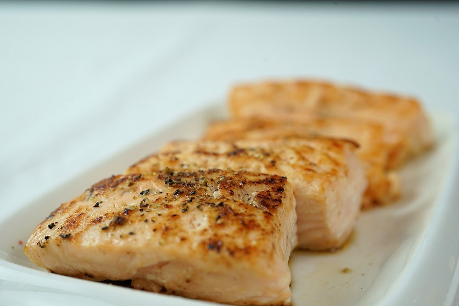 Simple Crock Pot Recipes with 3 Ingredients Overhead View of Three Pieces of Cooked Salmon on a White Plate