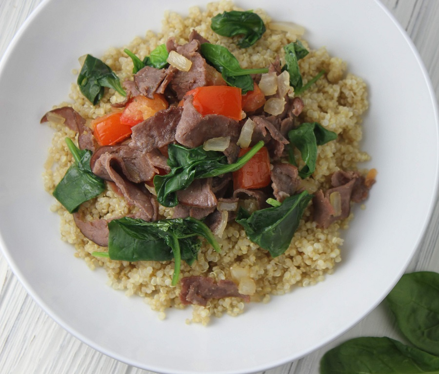 This recipe for sautéed spinach and beef can be served with quinoa or brown rice and allows you to get in a large serving of healthy spinach in the process! The best part is that everyone in the family will love this easy recipe. Healthy Recipes | How to Cook Quinoa | How to Cook Spinach | How to Eat Healthy | Recipes with Spinach | Healthy Recipes with Beef