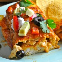 This easy chicken enchiladas recipe tastes like what you find at your favorite Mexican restaurant. Pair with a red or green sauce of your liking and you have a top ten family recipe on your hands! How to Make Enchiladas   Enchiladas at Home   Enchilada Sauce   Mexican Food Recipe   Enchiladas for Families