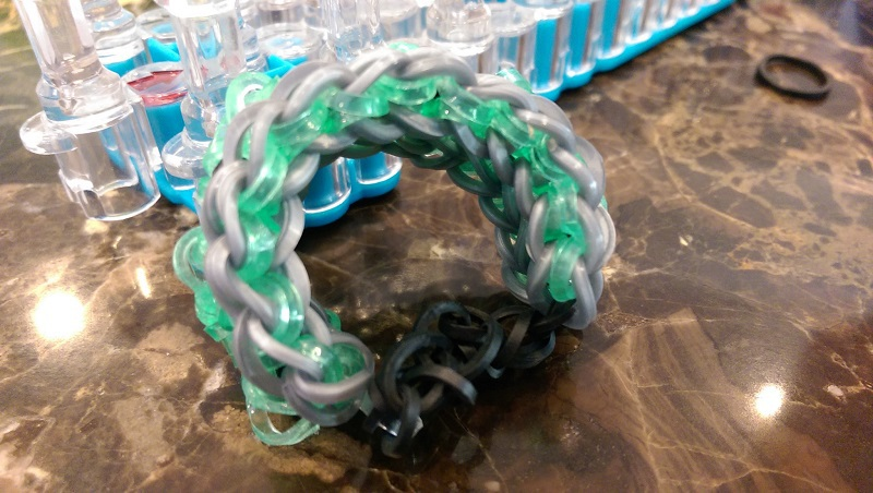 Our rainbow loom tutorials have been so popular so today Cal is sharing how to make a Starburst Rainbow Loom with step-by-step instructions.