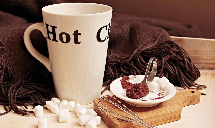 Fall Recipes Close Up of a Mug That Says Hot Chocolate with Cocoa and Marshmallows Around it