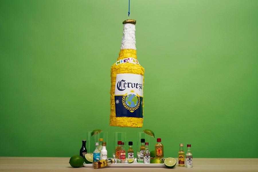 Cinco de Mayo Recipes Corona Bottle Pinata Haning Above Mexican Drinks