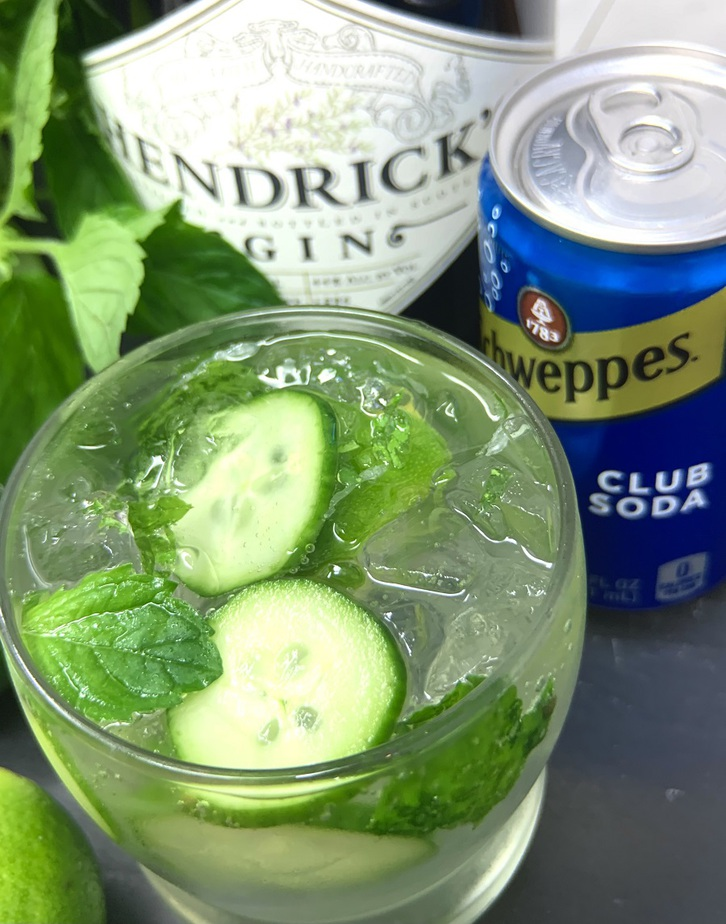 Sparkling Cucumber Cooler with Gin Cocktail Ingredients Gathered Together on a Counter