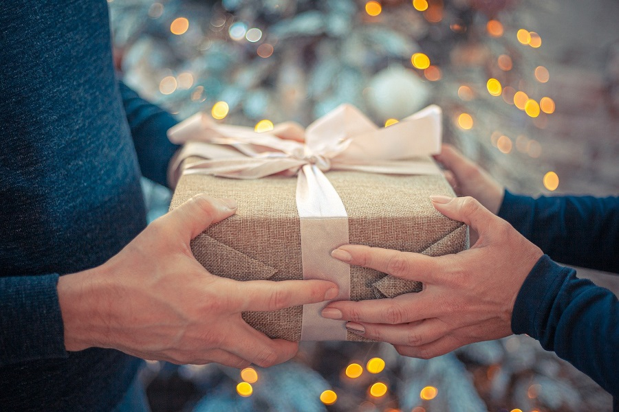 Tech Gifts For Men Man and Woman Holding a Gift