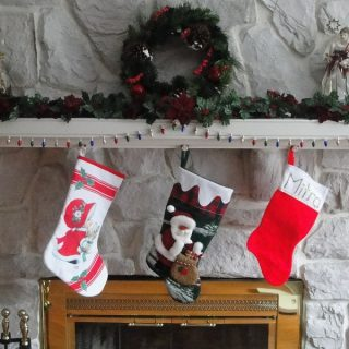 Stocking Stuffers for Men Three Stockings Hanging on a Fireplace