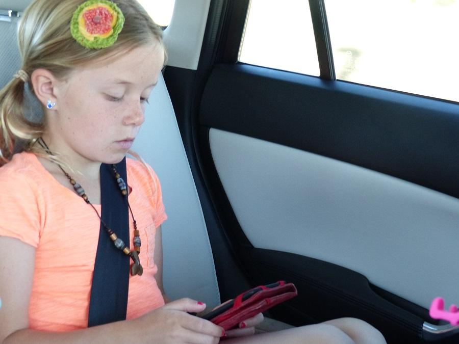 Ava reading Jacky Ha-Ha by James Patterson