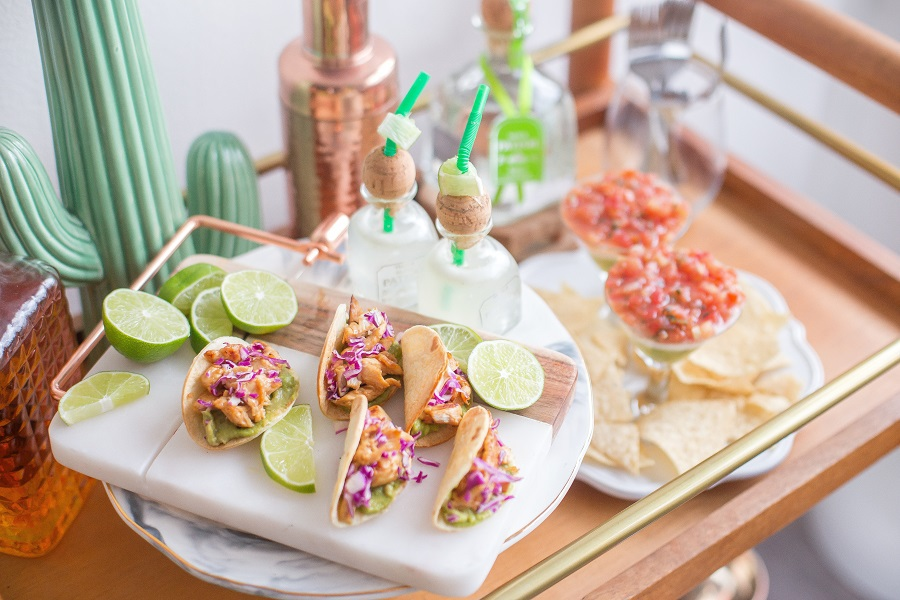 Cinco de Mayo Drinks Close Up of a Tray with Tacos and Patron Bottles