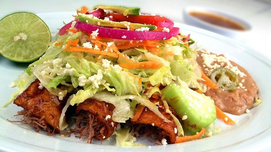 Cinco de Mayo Foods Red Enchiladas on a Plate