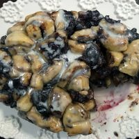 Crockpot monkey bread cinnamon rolls with cherries are easy to make in the crockpot for a fun breakfast treat or during any gathering.
