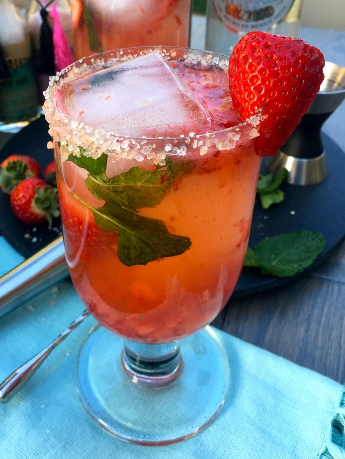 This clean tasting light strawberry margarita recipe will let you enjoy your favorite cocktail recipe without all the added calories! How to Make a Margarita | What's in a Strawberry Margarita | How to Use Fresh Fruit in a Margarita