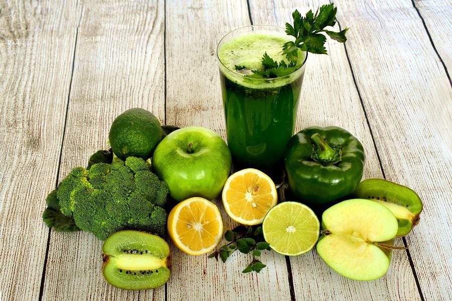 Jillian Michaels Detox Tips a Cup of Green Juice