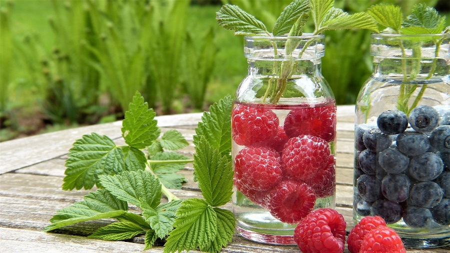 Jillian Michaels Detox Tips Two Mason Jars Filled with Water and Fruit