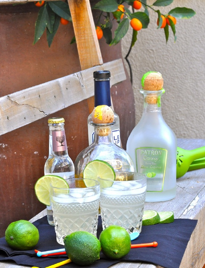 Patron Skinny Margarita recipe Ingredients on a Table with Two Glasses Filled with Margarita