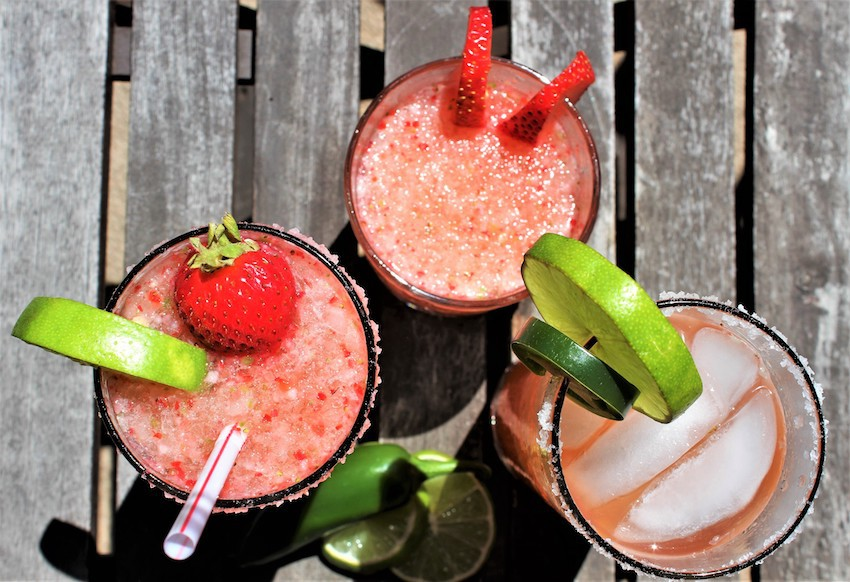 This strawberry jalapeño margarita is sweet, spicy, and totally refreshing. If you love margaritas this tequila cocktail needs to be added to your regular list of recipes! Strawberry Margarita Recipe | How to make a Margarita | Jalapeno Cocktails | Tequila Cocktail Recipes