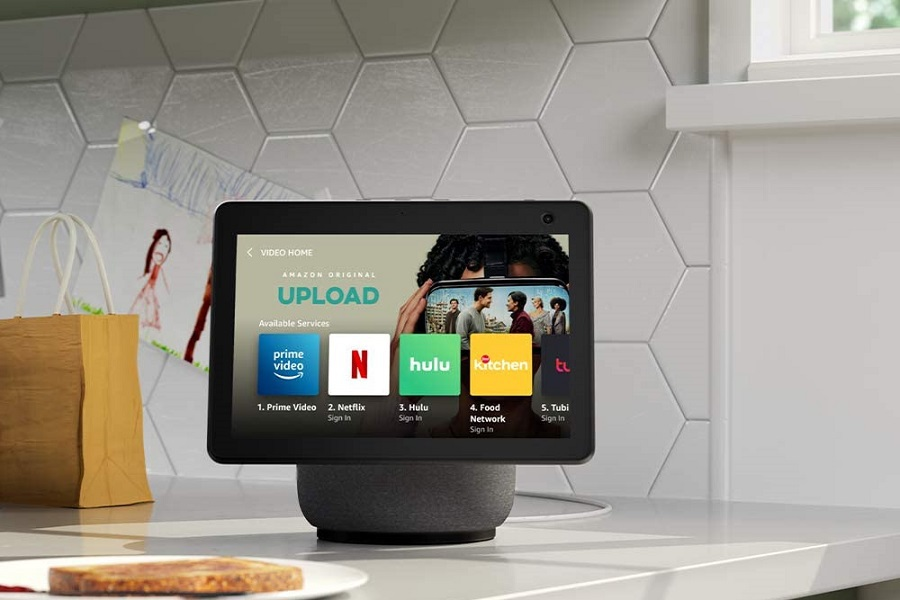 Amazon Echo Show on a Counter in a Kitchen with Entertainment Apps on the Home Screen