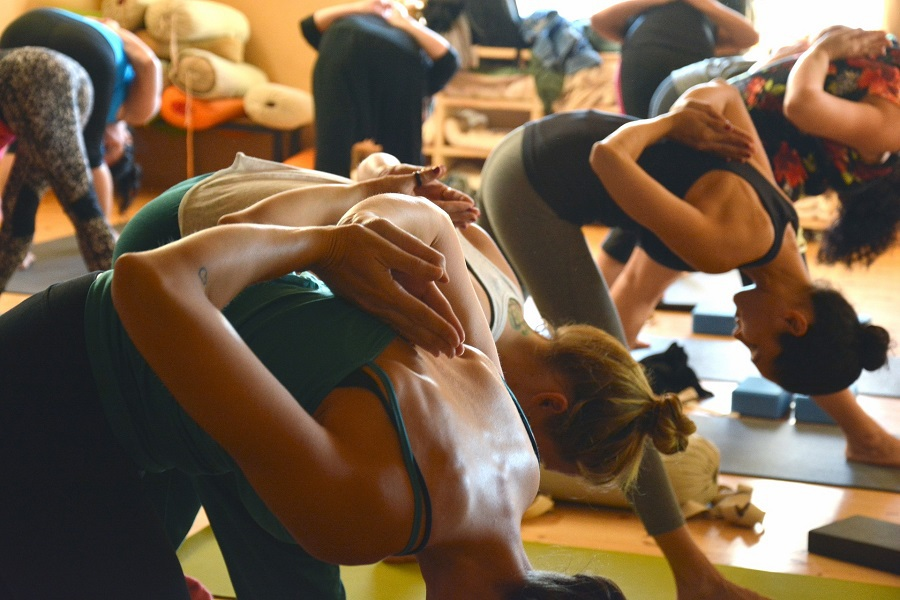 80 Day Obsession Women in a Yoga Workout Group