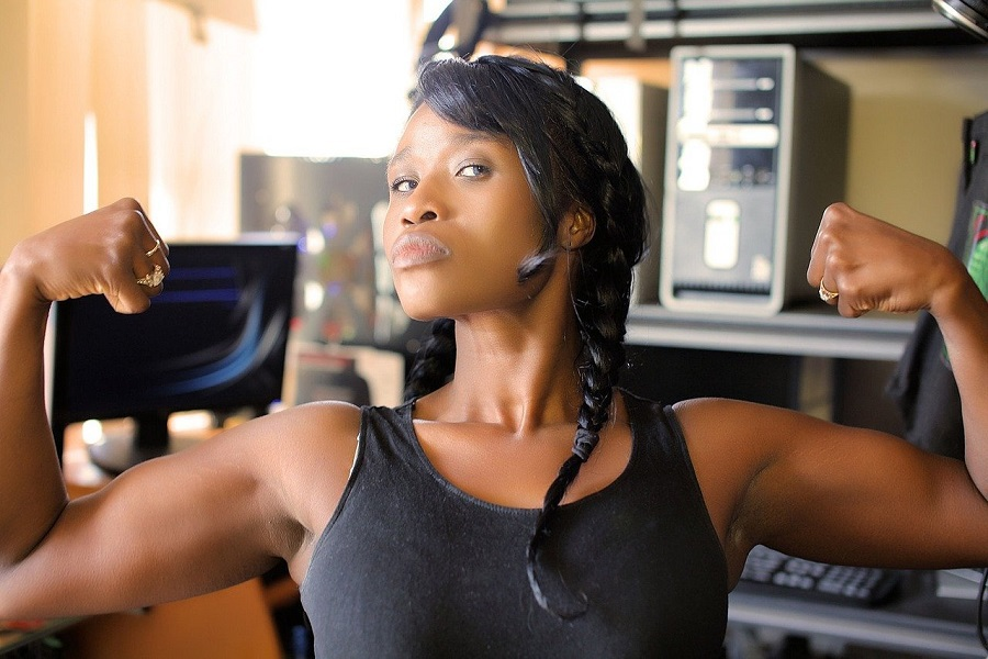 80 Day Obsession Close Up of Woman Flexing Her Biceps