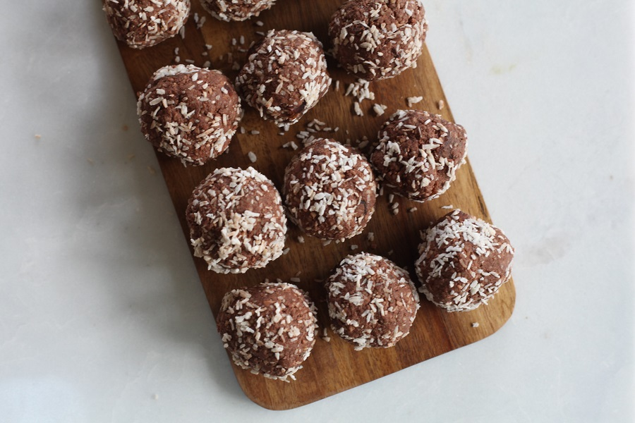 Dairy Free Keto Fat Bombs to Curb Cravings Overhead View of a Platter with Chocolate Fat Bombs Sprinkled with Coconut