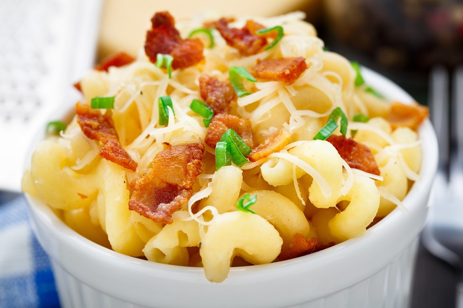 """Easy macaroni and cheese crockpot recipes...Just the mention of the rich and creamy comfort dish, more lovingly called """"Mac-n-cheese"""" is enough to bring smiles to a hungry crowd. How to Make Macaroni and Cheese in a Crockpot 