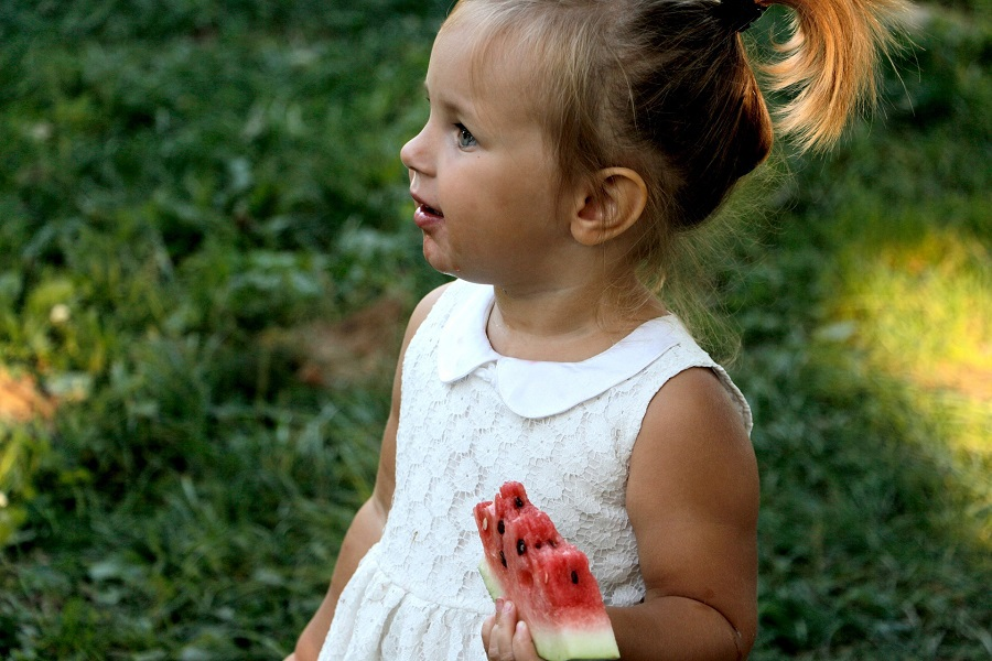 Dairy Free Recipes for Toddlers Little Girl Eating a Piece of Watermelon Outside