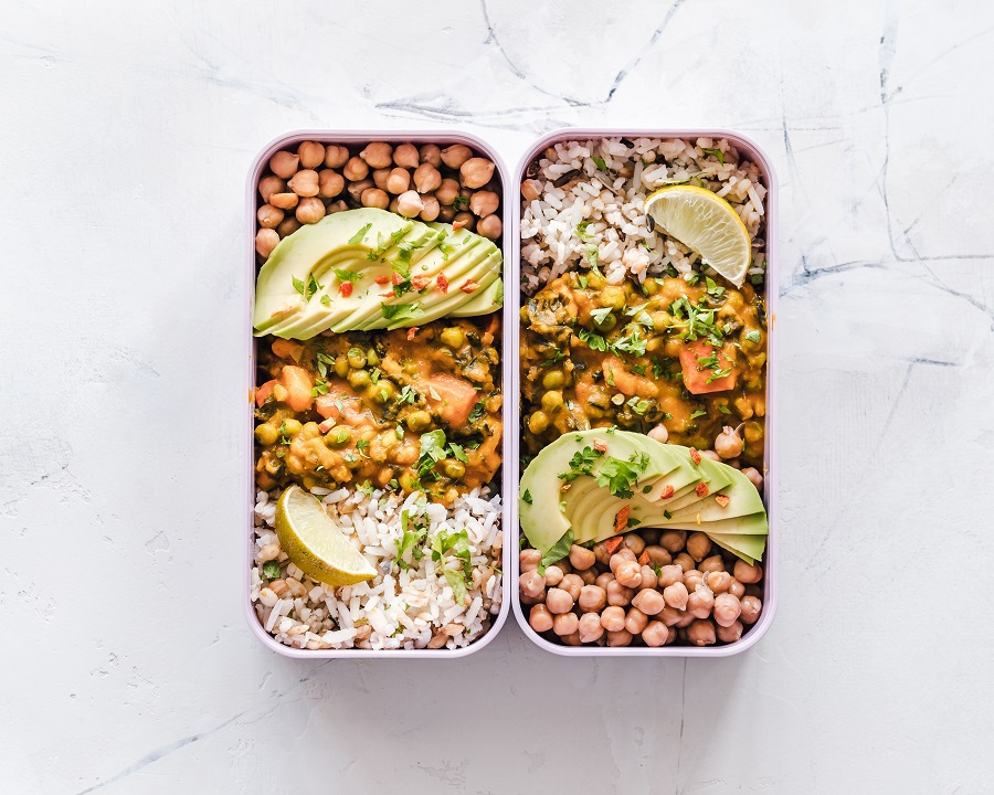 Overhead View of Meal Prep Recipes Divided up into Containers