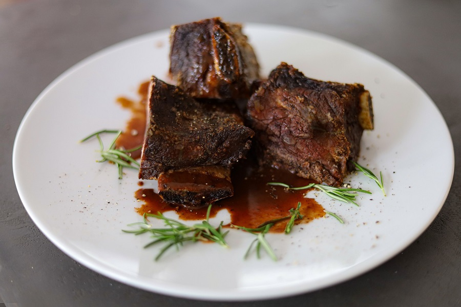 Crockpot Wine Braised Short Ribs Recipes Close Up of a Plate with Three Short Ribs on it