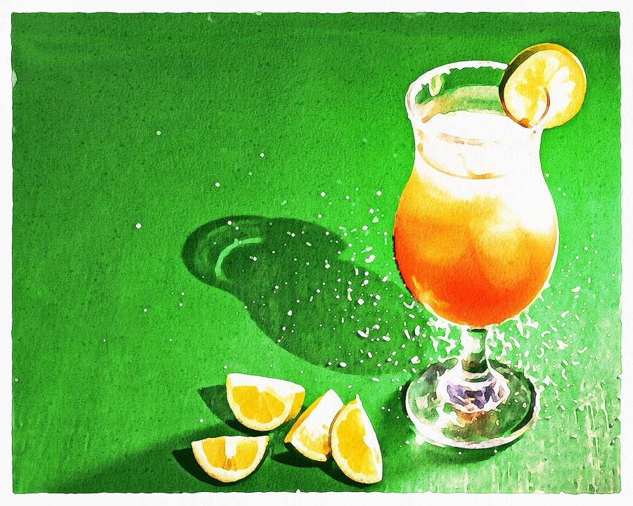 Margarita Recipes with Grand Marnier A Glass of Margarita with Lime Wedges Next to it on a Green Surface