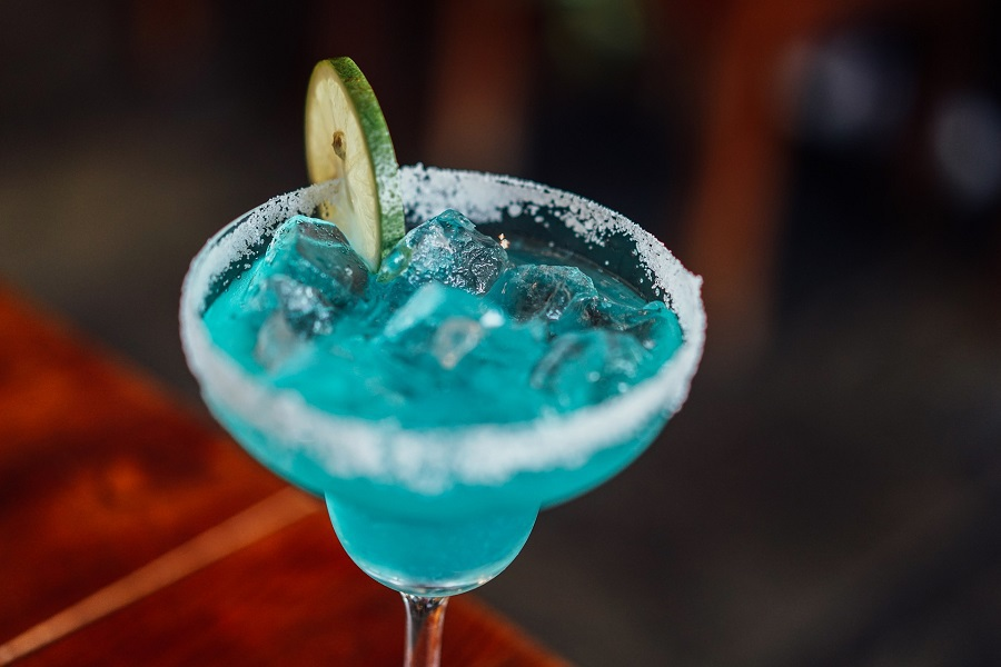 Margarita Recipes with Grand Marnier Close Up of a Blue Margarita on the Rocks with a Lime Slice on the Rim