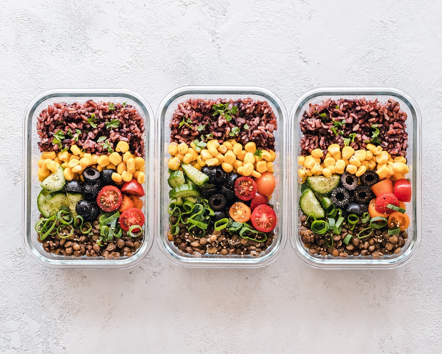 What Can You Eat on a Pegan Diet Overhead View of a Few Meal Prep Containers on a Counter Top