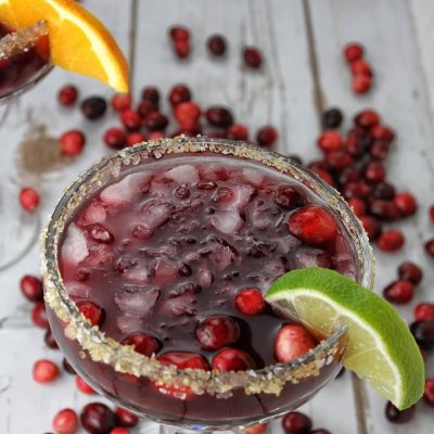 Cranberries lend themselves perfectly to the holidays and this cranberry margarita recipe balances tequila with seasonal cranberries perfectly! Cranberry Margarita by the Glass   Spiced Cranberry Margarita   Holiday Margarita Recipe   Holiday Party Recipe   Christmas Party Recipe   Christmas Cocktail Recipe