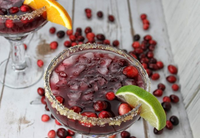 Cranberries lend themselves perfectly to the holidays and this cranberry margarita recipe balances tequila with seasonal cranberries perfectly! Cranberry Margarita by the Glass | Spiced Cranberry Margarita | Holiday Margarita Recipe | Holiday Party Recipe | Christmas Party Recipe | Christmas Cocktail Recipe