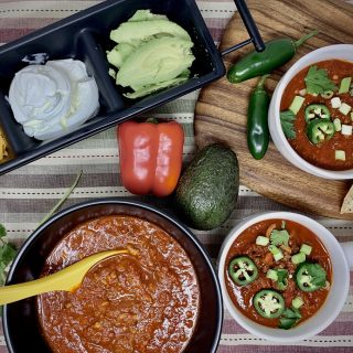 2B Mindset Instant Pot Chili Recipe Overhead View of Three Bowls of Chili with a Serving Tray of Other Toppings