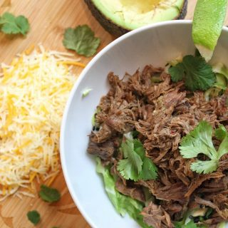 Low Carb Crock Pot Beef Barbacoa Overhead View of Beef in a Bowl with Cilantro and Shredded Cheese