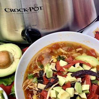 This delicious slow cooker chicken tortilla soup is not only an easy crockpot dinner recipe, but it is also an easy crockpot lunch and snack recipe. Chicken Tortilla Soup Slow Cooker | Authentic Chicken Tortilla Soup | Mexican Chicken Tortilla Soup Recipe