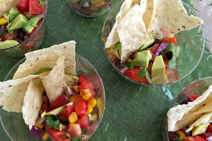 Black Bean Salsa with Avocado Recipe Overhead View of Mini Plastic Cups Filled with Bean Salsa