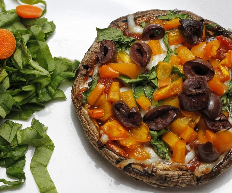 Low Carb Portobello Mushroom Pizza Recipe Cooked Pizza with Raw Ingredients Scattered Around
