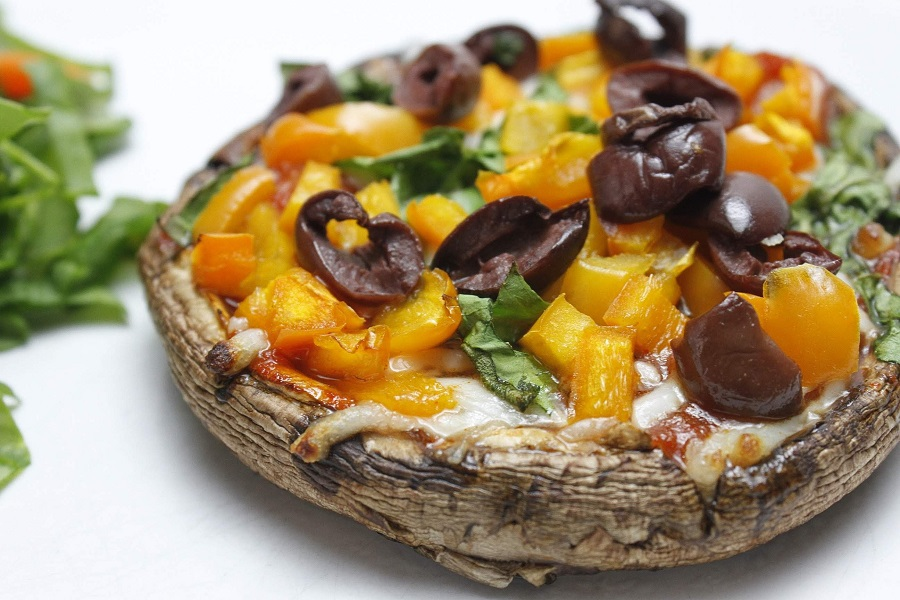 Low Carb Portobello Mushroom Pizza Recipe Cooked Pizza with Yellow and Black Toppings