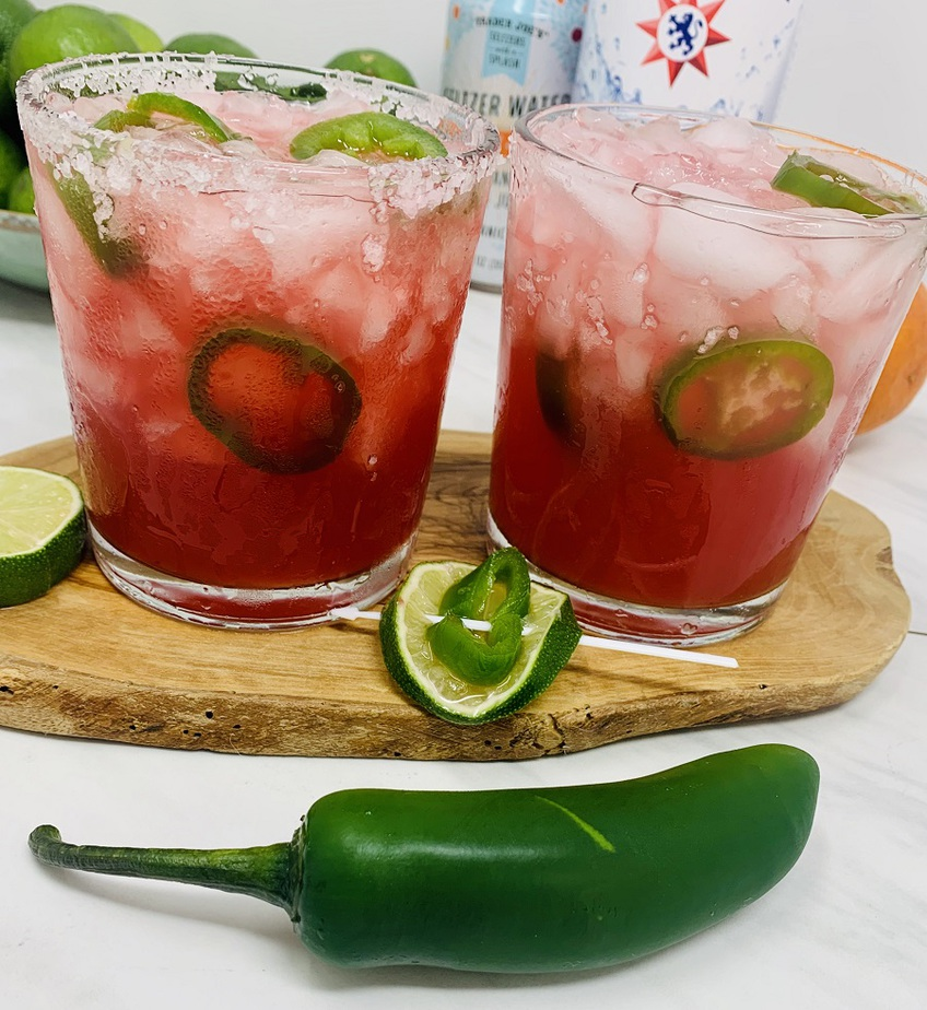 Spicy Margarita Recipe Two Glass of Margarita with Jalapenos Floating in it and Raw Jalapenos on the Side