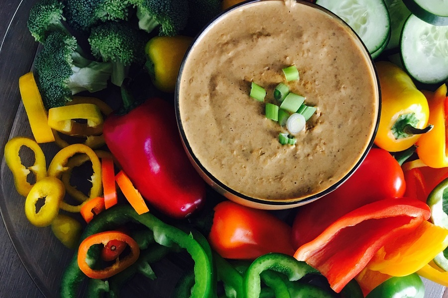 Crockpot Black bean Dip Recipe Over Head View of Dip in a Bowl with Peppers Around It