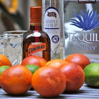 Fruity Margarita Recipes Ingredients and Fruit Gathered Together on a Table Outside