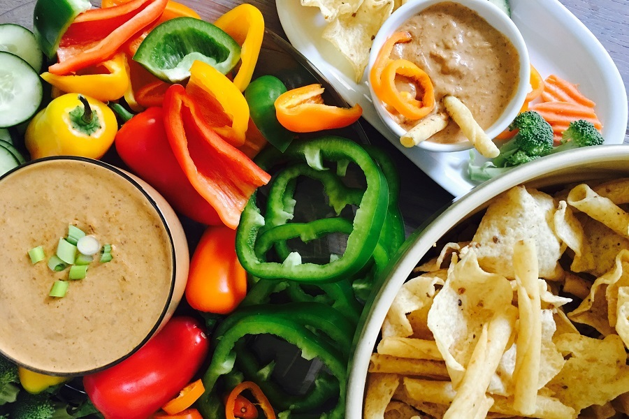 Crockpot Black Bean Dip Recipe Overhead View of Dip in a Bowl Next to a Big Bowl of Chips