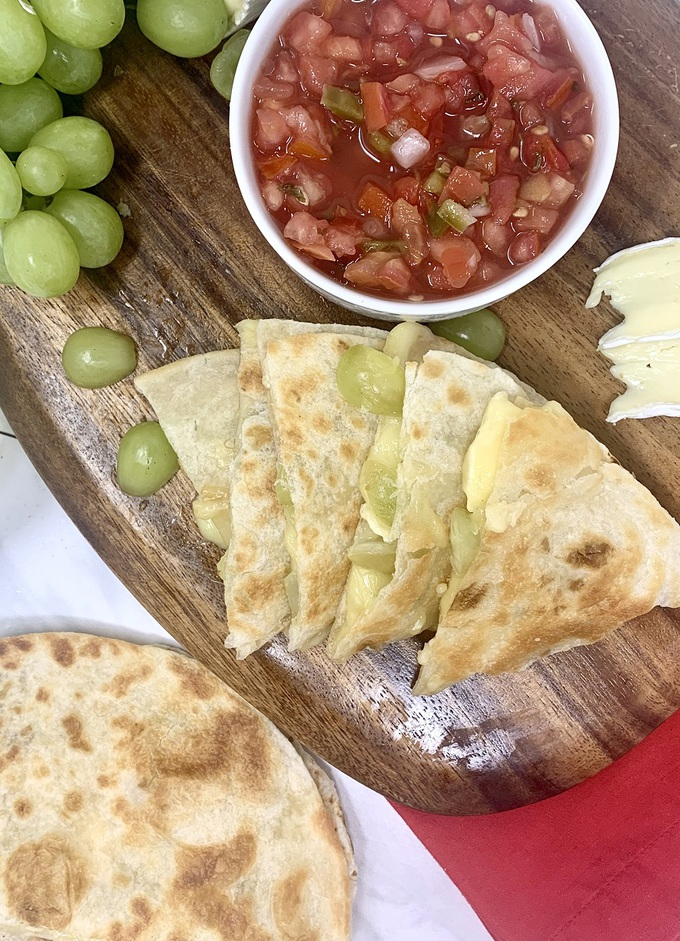Brie and Grape Quesadilla Recipe Cooked Quesadilla on a Cutting Board