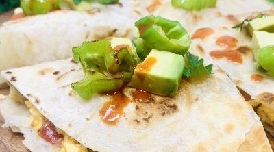 Healthy Breakfast Quesadilla Recipe Finished Quesadilla on a Cutting Board Close Up with Avocado