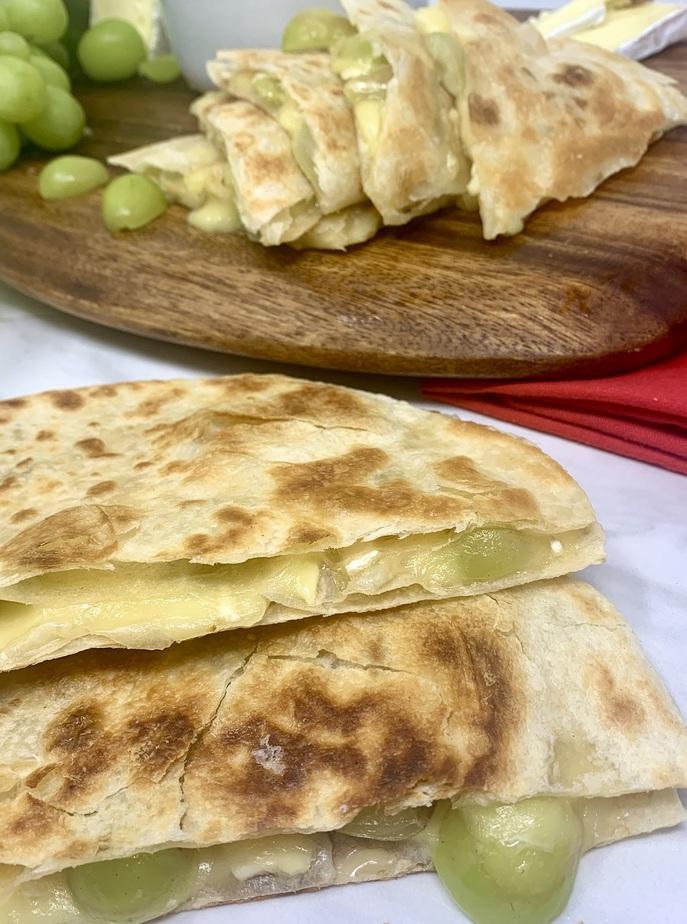 Brie and Grape Quesadilla Recipe Close Up of Quesadilla Cut into Quarters on a Counter
