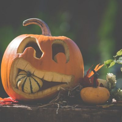 Halloween Crockpot Recipes Carved Pumpkin Holding Another Pumpkin in its Mouth