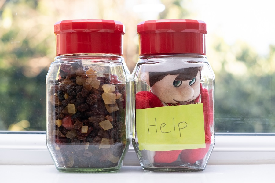 "Elf on the Shelf Crockpot Ideas Elf Trapped in a Jar with a Sign That Says ""Help"""