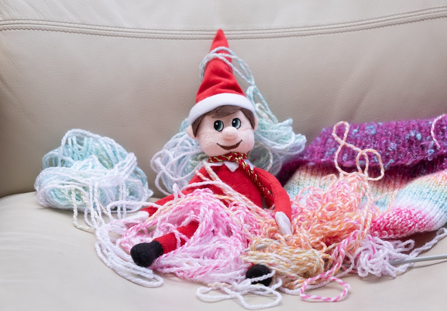 Elf on the Shelf Crockpot Ideas Elf on a Couch Covered in Loose Yarn