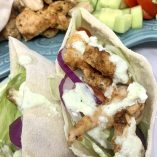 Chicken and Tzatziki in Pita Pockets Close Up of Pita with Chicken, Sauce, and Toppings